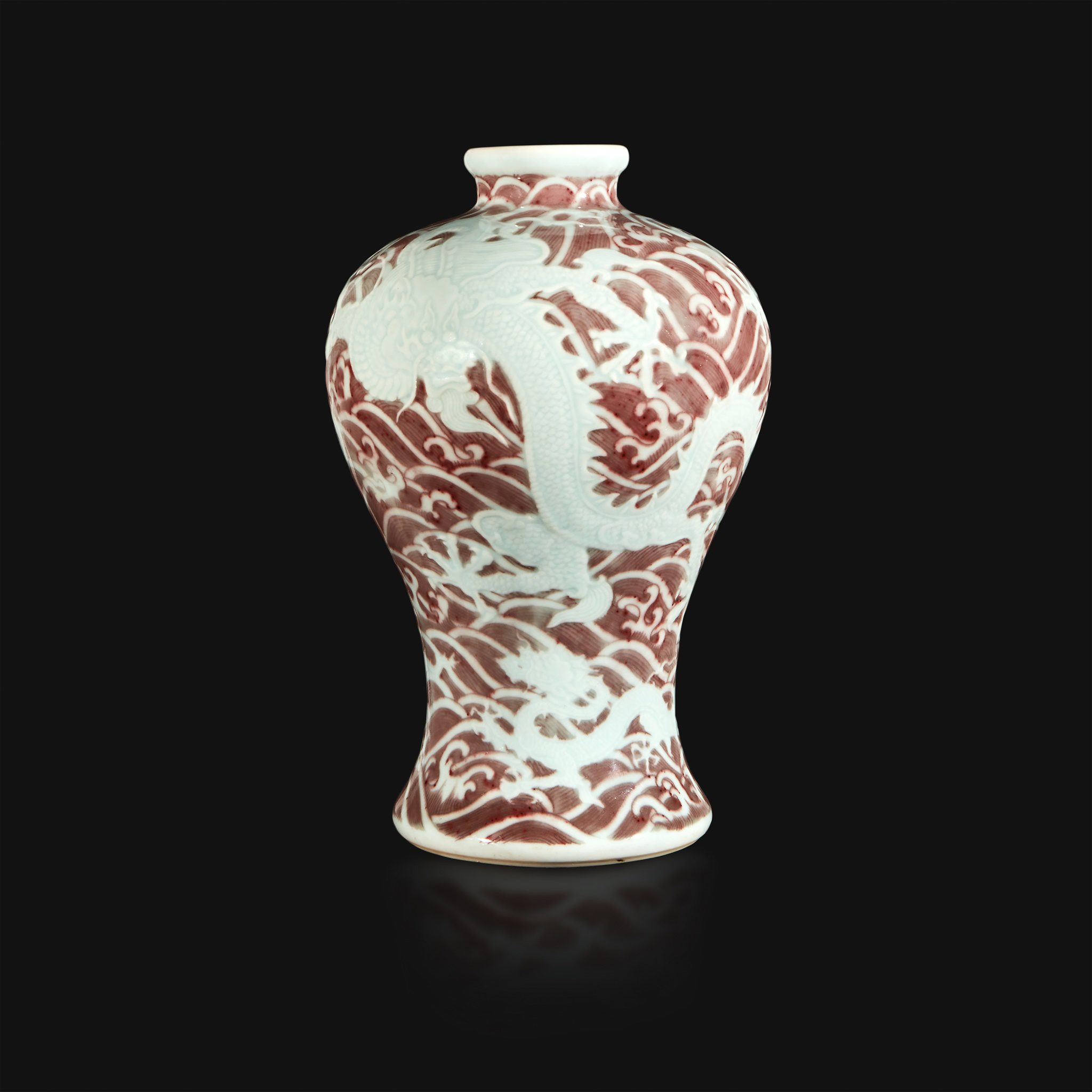 "Chinese carved and underglaze red ""Dragons and Waves"" vase (Lot 12, $150,000-250,000) Freeman's Auction"